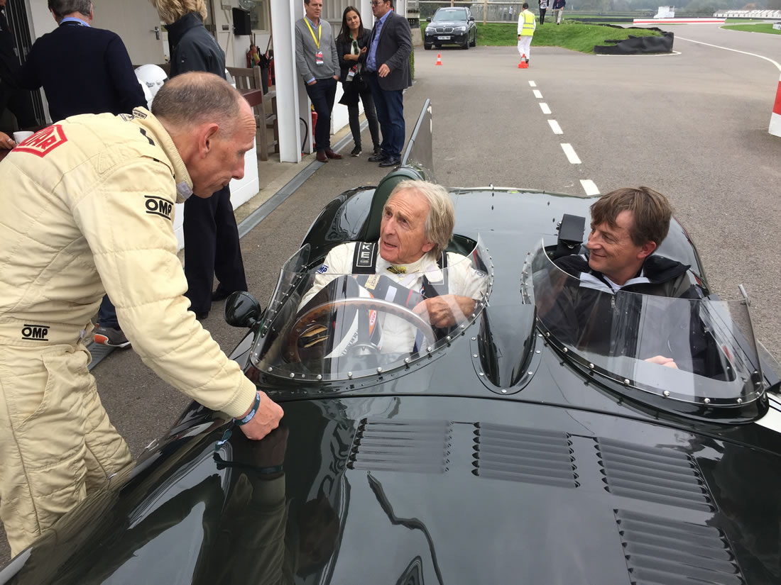 Jeremy Hoyland with racing driver Derek Bell in classic Jaguar